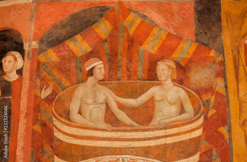 Woman and man bathing on 14th century fresco inside historical Palazzo del Podesta