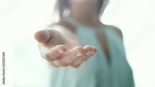 Inviting invitation Gesture lends a helping hand by young woman Fototapet