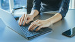 Close-up On the Hands of a Businesswoman Typing on a Laptop Keyboard. Female Using Laptop in the Office.