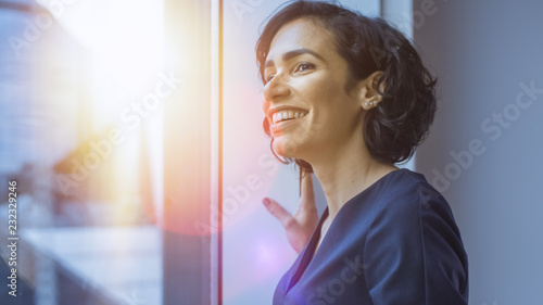 Obraz Close-up Portrait of the Beautiful Young Hispanic Woman Looking out of the Window in Wonder. Summertime with Sun Flares in Frame. - fototapety do salonu