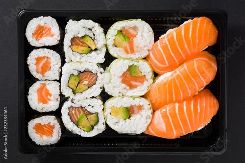Fototapeta Maki and nigiri sushi set on black background. Top view obraz