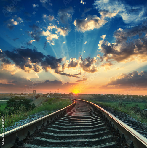 good sunset in clouds over railroad