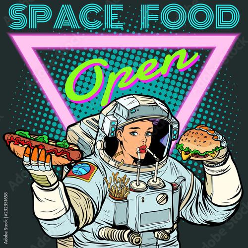 Obraz na plátně Space food. Woman astronaut eats. Cola, hot dog and Burger.