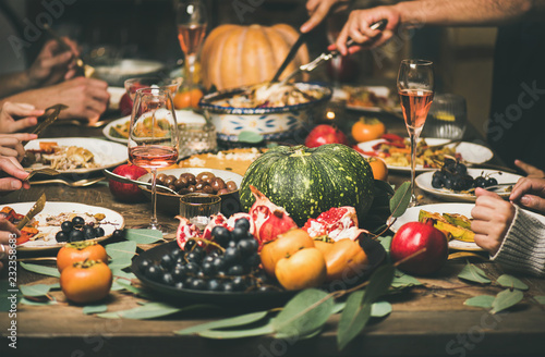 Foto op Plexiglas Assortiment Traditional Christmas or New Year holiday celebration party. Friends or family eating different snacks at Festive Christmas table, selective focus, horizontal composition