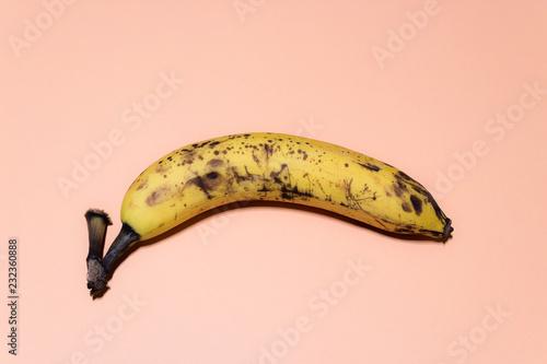 One ripe banana isolated on powdery background. pastel background