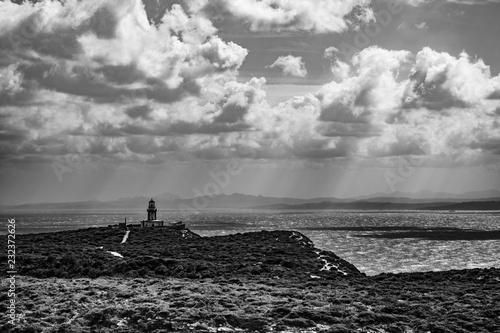 Fototapety, obrazy: Black and white lighthouse at dramatic coast
