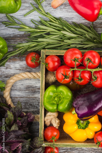 Fotografie, Obraz  Set of different fresh raw colored vegetables in the wooden tray