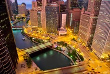 Aerial View Of Downtown Chicago After Sunset At The Blue Hour. Wacker Drive, Michigan Avenue, Wabash Avenue And The Chicago River