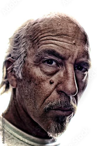 Foto  Highly detailed portrait of older white man with gray hair and goatee, back lit, not isolated
