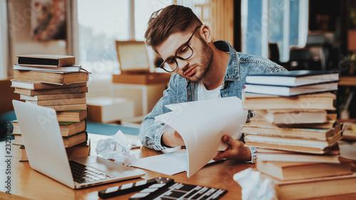 Fototapeta Pensive Freelance Text Writer Working at Desk obraz