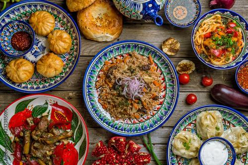 Photo  dishes of Uzbek cuisine lagman, pilaf, manti