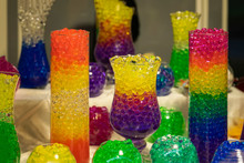 Several Glass Vases With A Absorbent Balls Of Hydrogel, Bright Colored Colors
