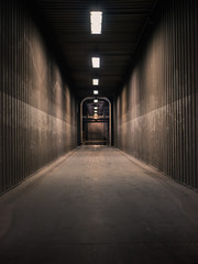 Empty hallway in a factory with neon lights shining