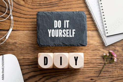 Photo Message Do it yourself and cubes with acronym DIY on wooden background