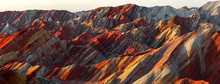 Zhangye Danxia National Geopark - Gansu Province, China. Chinese Danxia Multicolor Danxia Landform, Rainbow Hills, Unusual Colored Rocks, Sandstone Erosion, Layers Of Red, Yellow And Orange Stripes.