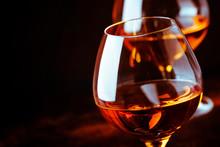 Grape Brandy In Shot Glass, Dark Brown Background, Selective Focus