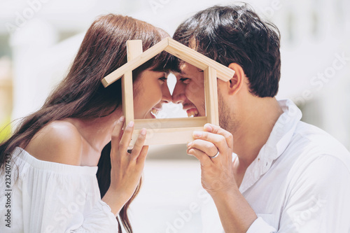Young couple planning to buy a house and have happy living. - fototapety na wymiar