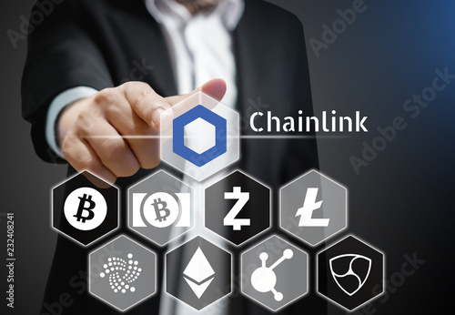 Business man points his finger at Chainlink coin icon among others