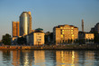 urban landscape in the rays of the setting sun. embankment. a variety of architectural styles