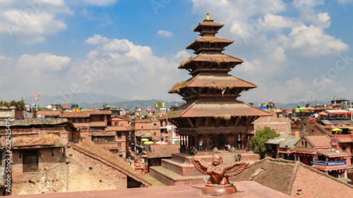 Wall Murals Nepal Statue and Nyatapola temple in the background