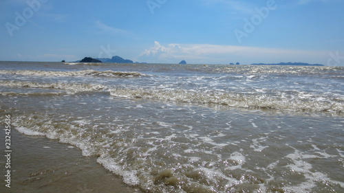 sea water foam on the beach in a sunny day of summer at Pak Meng Beach Trang province,Thailand