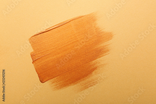 Strokes of gold paint on color background - Buy this stock