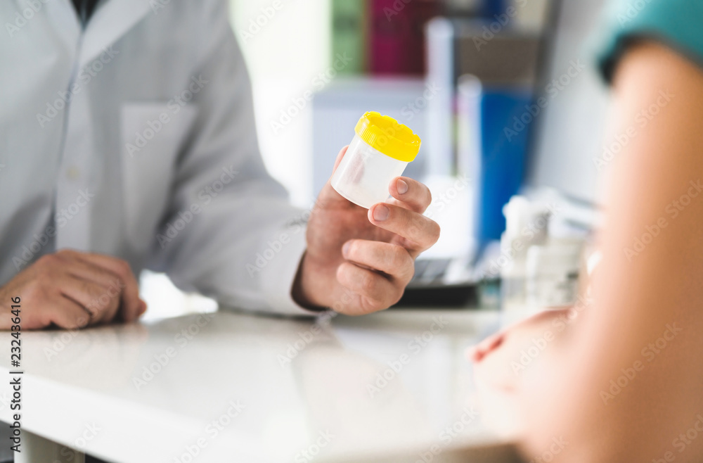 Fototapety, obrazy: Doctor, patient and urine test cup. Physician giving pee container to a woman in clinic or hospital emergency room. Urinary sample for medical exam in hospital. Checkup for infection or salmonella.