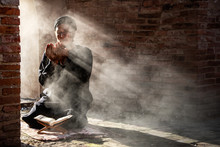 Silhouette Of Muslim Male Praying In Old Mosque With Lighting And Smoke Background