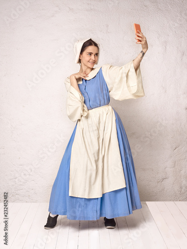 Medieval Woman in Historical Costume Wearing Corset Dress and Bonnet.