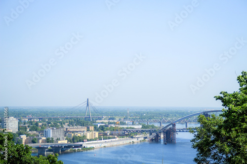 Tuinposter Purper View of the Dnipro River from the park. Kiev. Ukraine. Traveling Bridge to the city