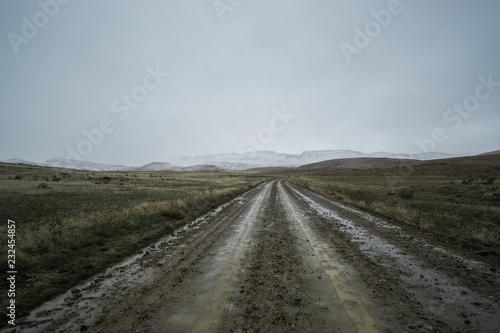 Fotografia  Wet dirt road through the desert in Eastern Oregon, USA