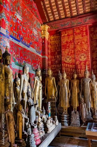 Fotografie, Obraz  Ancient Buddha statues at Wat Xieng Thong, Luang Prabang, Laos