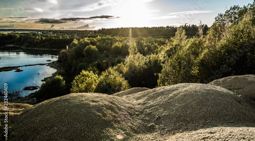 Sandy hills. Sandy canyon. Warm colors background. Yellow sandstone textured mountain, white thin sand dune, bright sky.