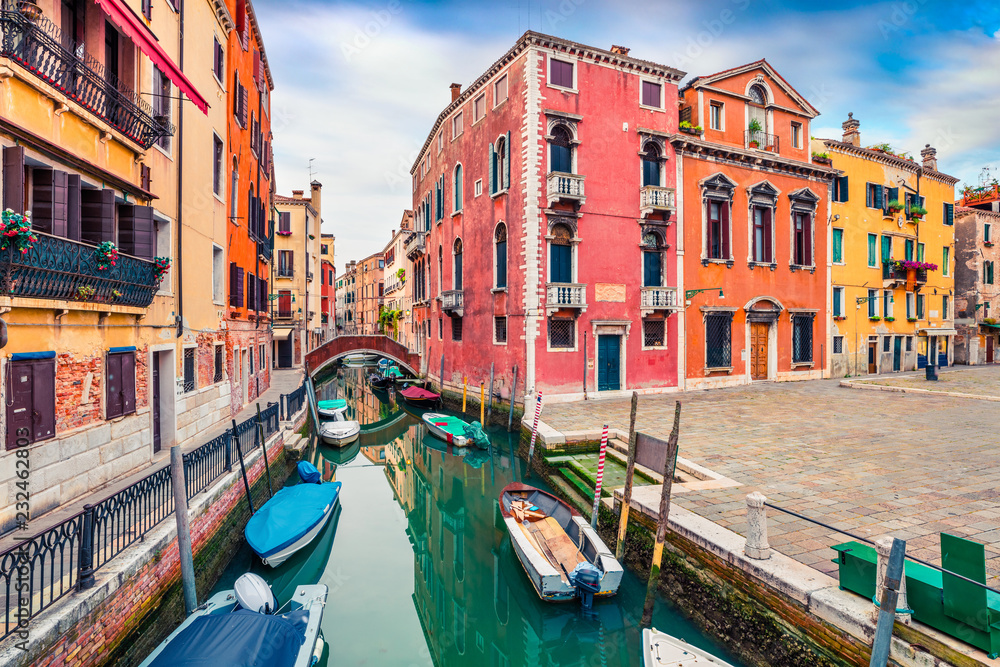 Picturesque spring view of Vennice with famous water canal and colorful houses. Splendid morning scene in Italy, Europe. Magnificent Mediterranean cityscape. Traveling concept background.