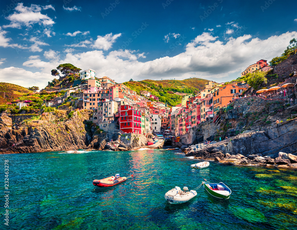 Fototapeta First city of the Cique Terre sequence of hill cities - Riomaggiore. Colorful morning view of Liguria, Italy, Europe. Great spring seascape of Mediterranean sea. Traveling concept background.