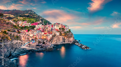 Canvas Prints Liguria Second city of the Cique Terre sequence of hill cities - Manarola. Colorful spring sunset in Liguria, Italy, Europe. Picturesqie seascape of Mediterranean sea. Traveling concept background.