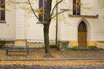 Fototapeta Side door of Gothic church in Zatec town. Autumn. Czech Republic.