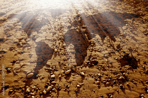 conceptual environmental image of world map and dirt land with rocks