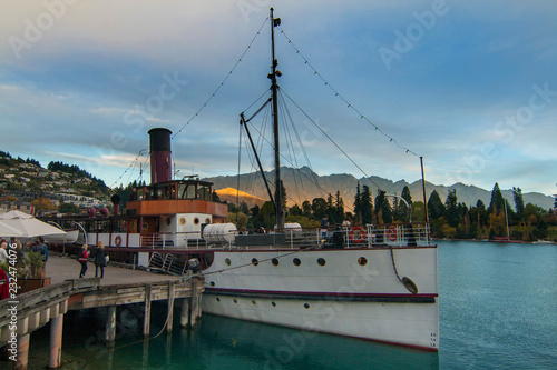 Sunset in Queenstown wharf with steamship attraction on lake Wakatipu, the famou Canvas Print