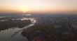 Magnificent sunset aerial view Stockholm Sweden. Drone flies backwards camera tilts up. Beautiful twilight urban skyline.