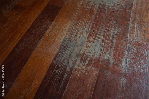 Obraz Old scratched hardwood flooring in need of maintenance. parquet ruined by scratches made by prolonged use of chair. - fototapety do salonu