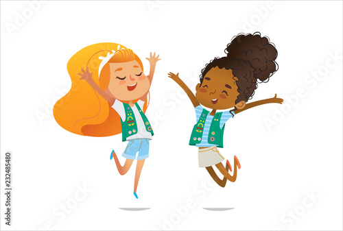 Fototapeta Young smiling girls scout dressed in uniform with badges and patches happily jump isolated on white background. Female scouter, member of troop, speaker. obraz