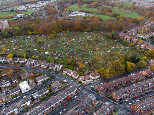 Fototapeta Aerial photo of a typical town in the UK showing rows of houses, paths & roads, taken over Headingley in Leeds, which is in West Yorkshire in the UK. obraz na płótnie