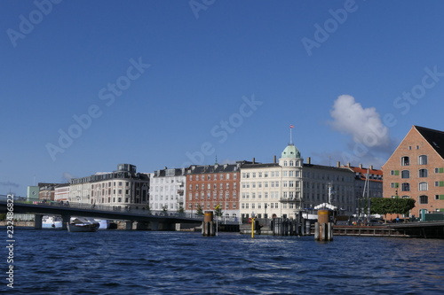 Panoramic view of a canal of Copenhagen with houses and a pedestrian bridge, Den Wallpaper Mural