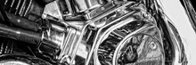 A Panoramic Photo Of Fragment Of A Motorcycle With Chrome Elements Reflecting Another Motorcycle