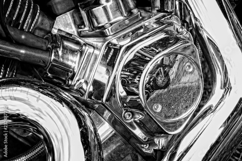 Fotografia, Obraz  A fragment of a motorcycle with chrome elements reflecting another motorcycle