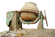Old And Rusty Concrete Mixer On The Ground Isolated On White