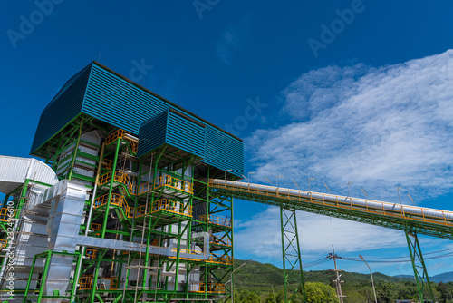 Photo Boiler tower and equipment at biomass power plant