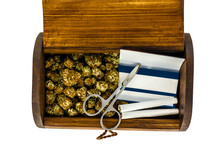 A Wooden Stash Box Half Filled With Green Marijuana Buds Covered In Rich Red Hairs With A Pair Of Scissors, 2 Prerolled Joints & A Pack Of Rolling Papers On A White Background.