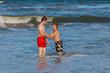 boys having fun in the beautiful clear sea